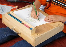 A divider forms separate areas for paper and a lift-out pencil box.